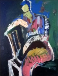 man seated in green